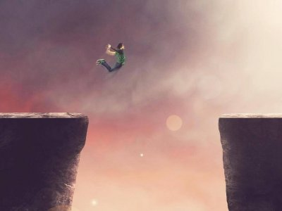 Illustration of a person jumping over a great chasm